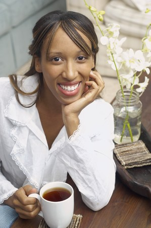 daydreamer: African American woman drinking coffee
