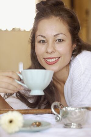 casualness: Close up of woman drinking tea