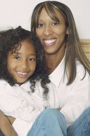 mother and teen daughter: African American mother and daughter smiling