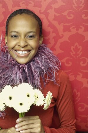 mischievious: African American woman holding flowers
