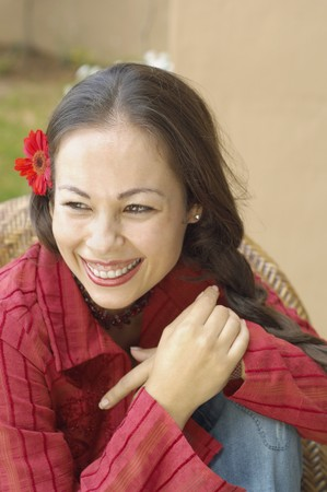 casualness: Woman smiling with flower in her hair LANG_EVOIMAGES