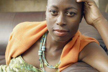 relishing: African American woman sitting on sofa