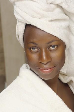 bathtowel: Close up of African American woman wearing bathrobe LANG_EVOIMAGES