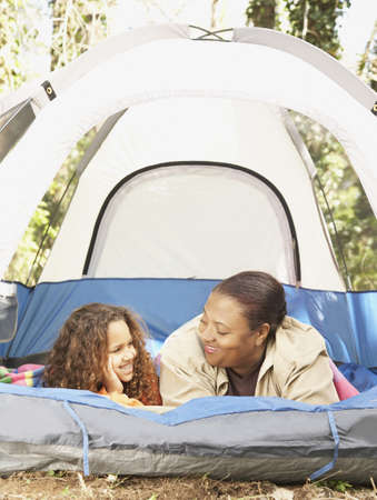 mischeif: African American mother and daughter camping