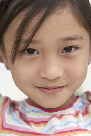 Close up of young Asian girl smiling