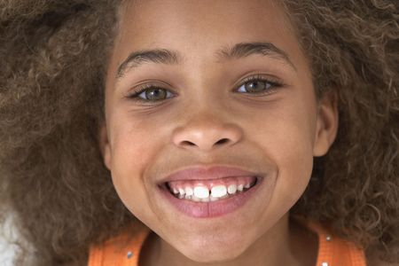 babyboomer: Close up of young African American girl smiling