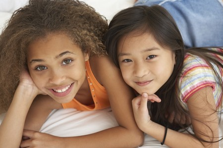 elementary age girl: Two young girls smiling