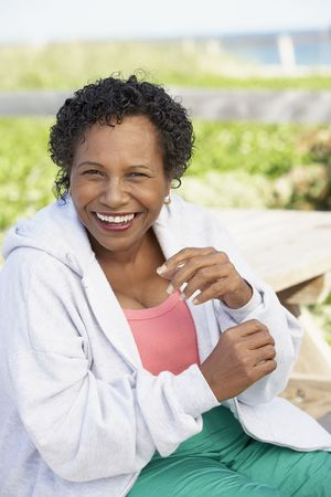 south eastern european descent: Senior woman laughing outdoors
