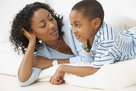 fond of children: African American mother and young son