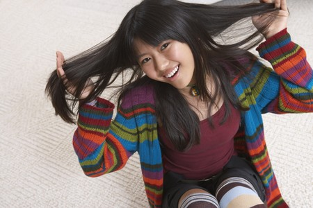 spectating: Asian girl with hands in hair LANG_EVOIMAGES