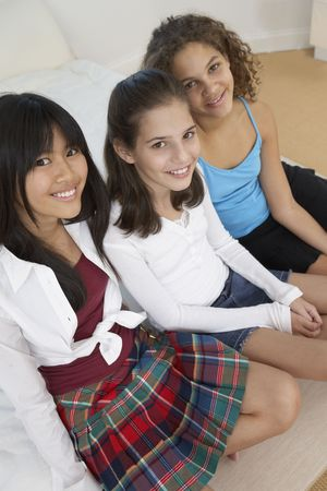 teenaged girls: Three teenaged girls smiling