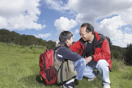 babyboomer: Asian father and son with backpacks outdoors