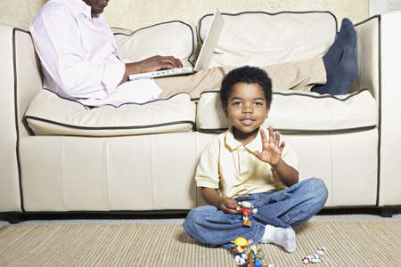 fathering: Young African American boy playing on floor