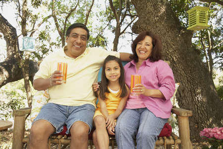 Hispanic family with drinks outdoors