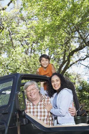 babyboomer: Hispanic grandparents with grandson in jeep