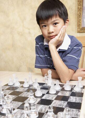 Asian boy playing chess