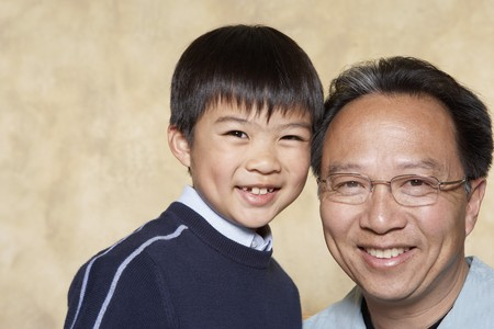 Asian father and young son smiling Banco de Imagens