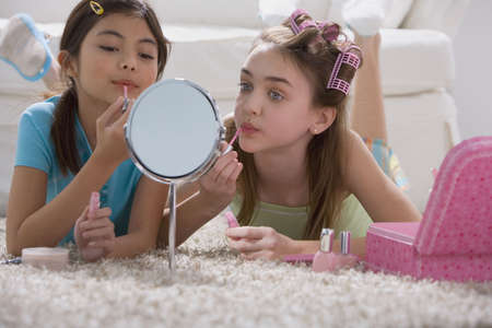 two persons only: Two young girls playing with makeup