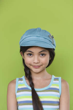 dressup: Studio shot of young Hispanic girl with hat