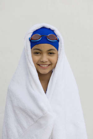 dressup: Hispanic girl in towel with swimming cap and goggles