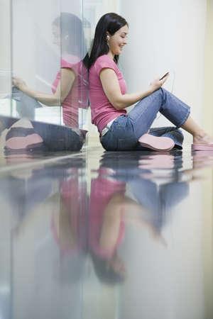 edmonds: Young woman sitting on reflective floor