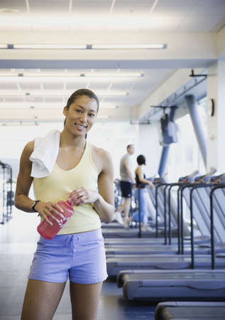 operate: Woman at gym with water