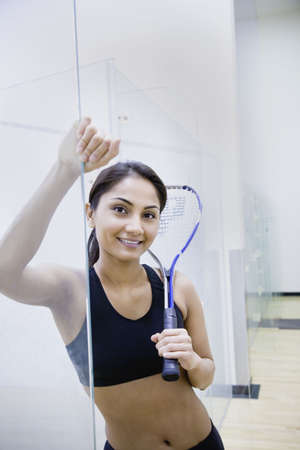 north western european descent: Woman with Squash racket indoors