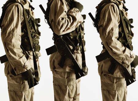 endangering: Studio shot of three soldiers LANG_EVOIMAGES