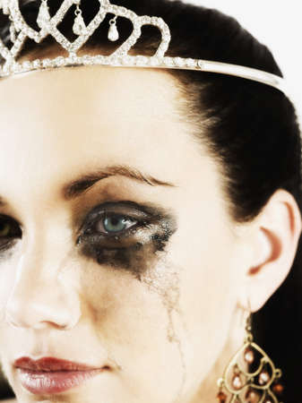 facing away: Woman wearing tiara and crying LANG_EVOIMAGES