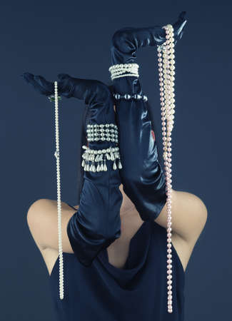 jeopardizing: Woman wearing gloves and pearls LANG_EVOIMAGES
