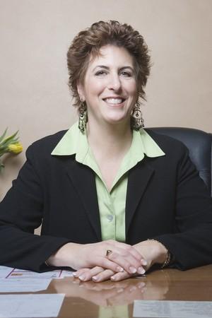 middleaged: Middle-aged businesswoman at desk LANG_EVOIMAGES
