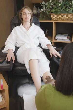 attentiveness: Woman receiving spa pedicure