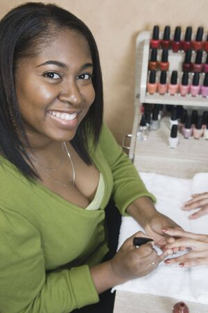 seriousness skill: African woman performing manicure