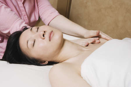 Asian woman receiving massage Stock Photo