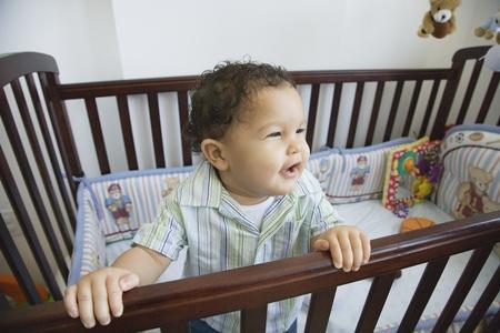African baby in standing crib Banco de Imagens