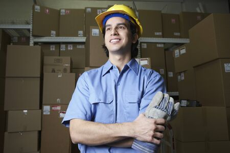 gaithersburg: Hispanic male warehouse worker with boxes