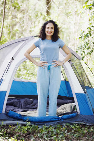 rousing: Woman standing next to tent