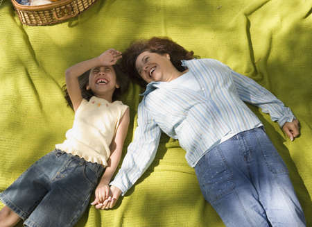 adventuresome: Mother and daughter laying on picnic blanket