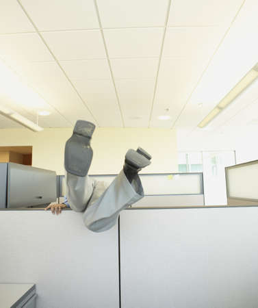 cubical: Businessman falling over cubical wall