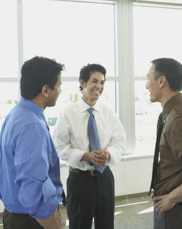 north western european descent: Male coworkers talking