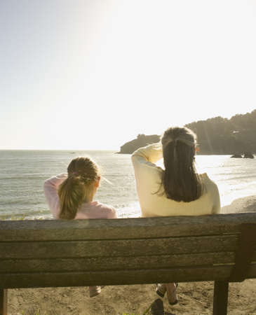 hilarity: Mother and daughter looking out over water