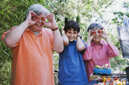 gramma: Hispanic family playing with food to be grilled
