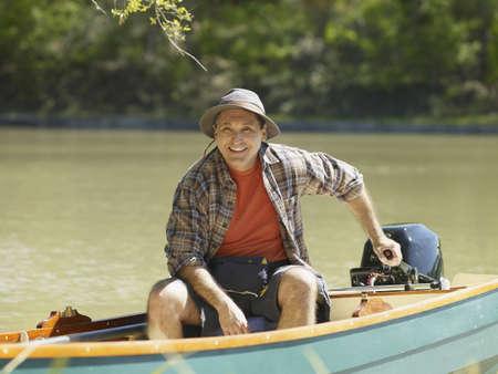 adventuresome: Hispanic man smiling in small boat