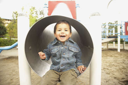 poppa: Young boy in slide