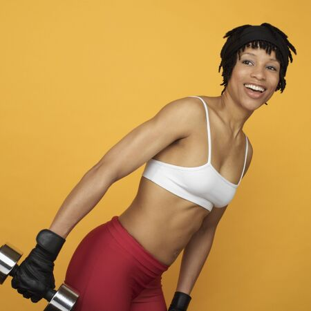 bathingsuit: African woman lifting weights LANG_EVOIMAGES