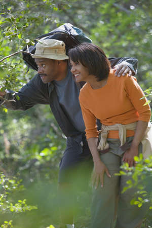 poppa: African couple hiking in woods
