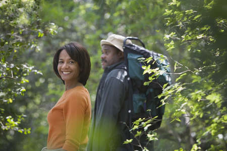 adventuresome: African couple hiking in woods