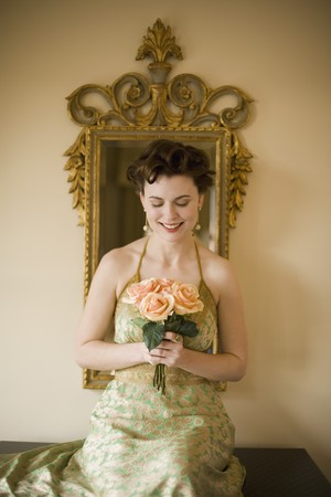mischeif: Woman wearing fancy dress and holding flowers