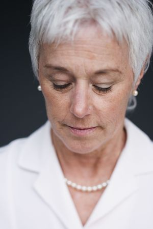 distressing: Close up of senior woman looking down