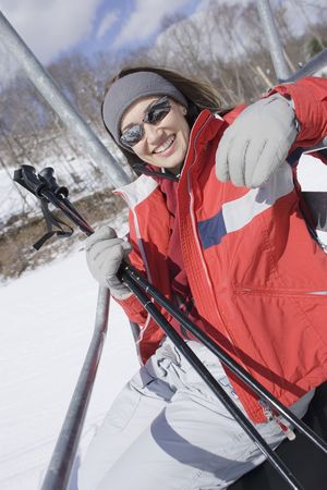 ski lift: Woman smiling on ski lift